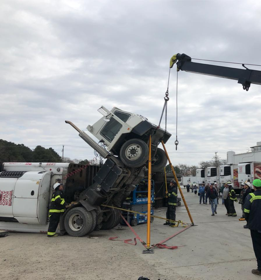 Tractor-trailer overturns at Smithfield Foods, firefighters