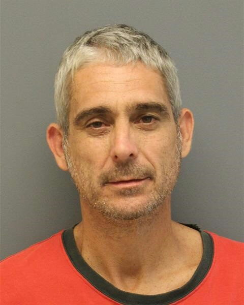 Canton man arrested after naked stroll outside motel in