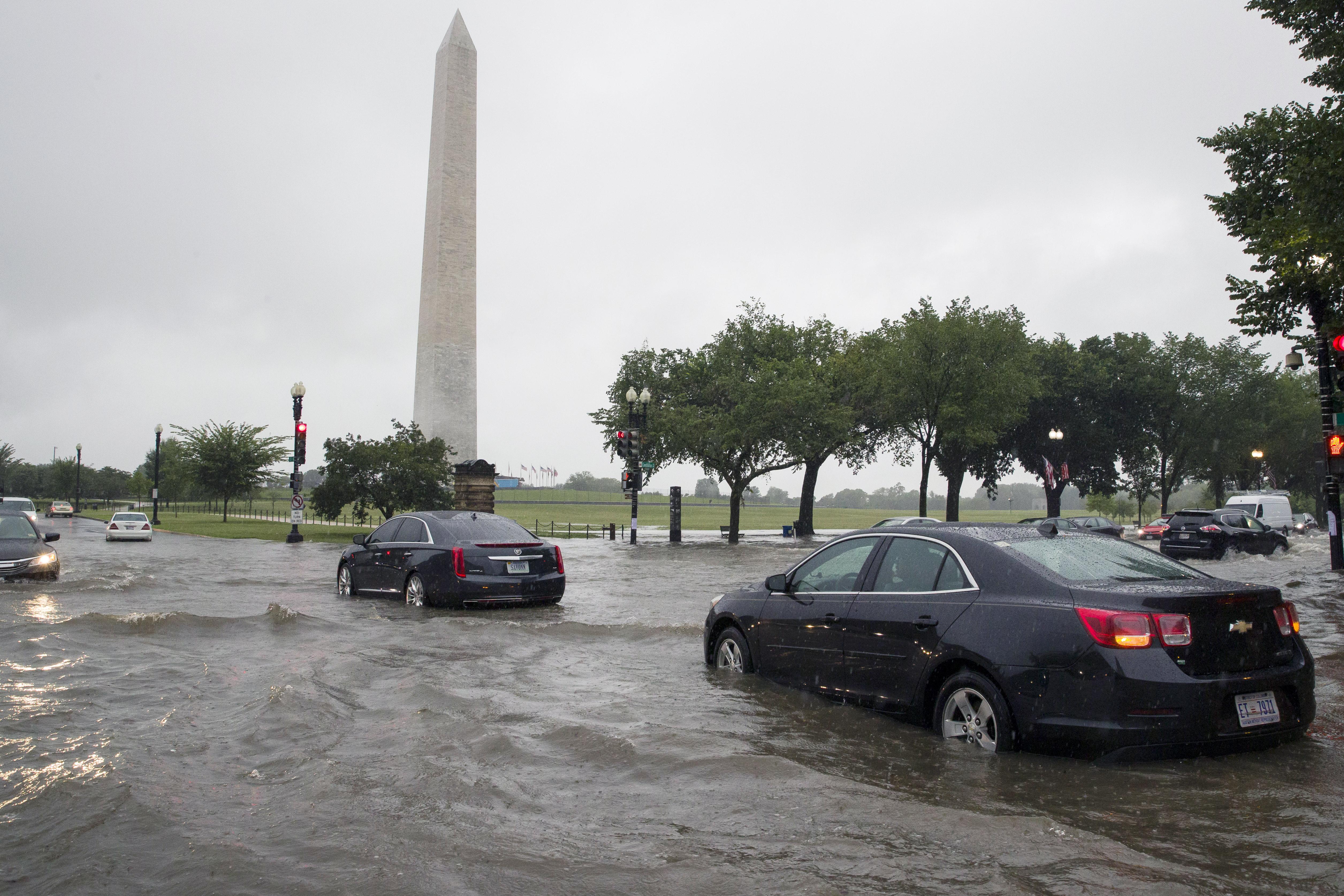 Rains strand Washington drivers, flood White House basement