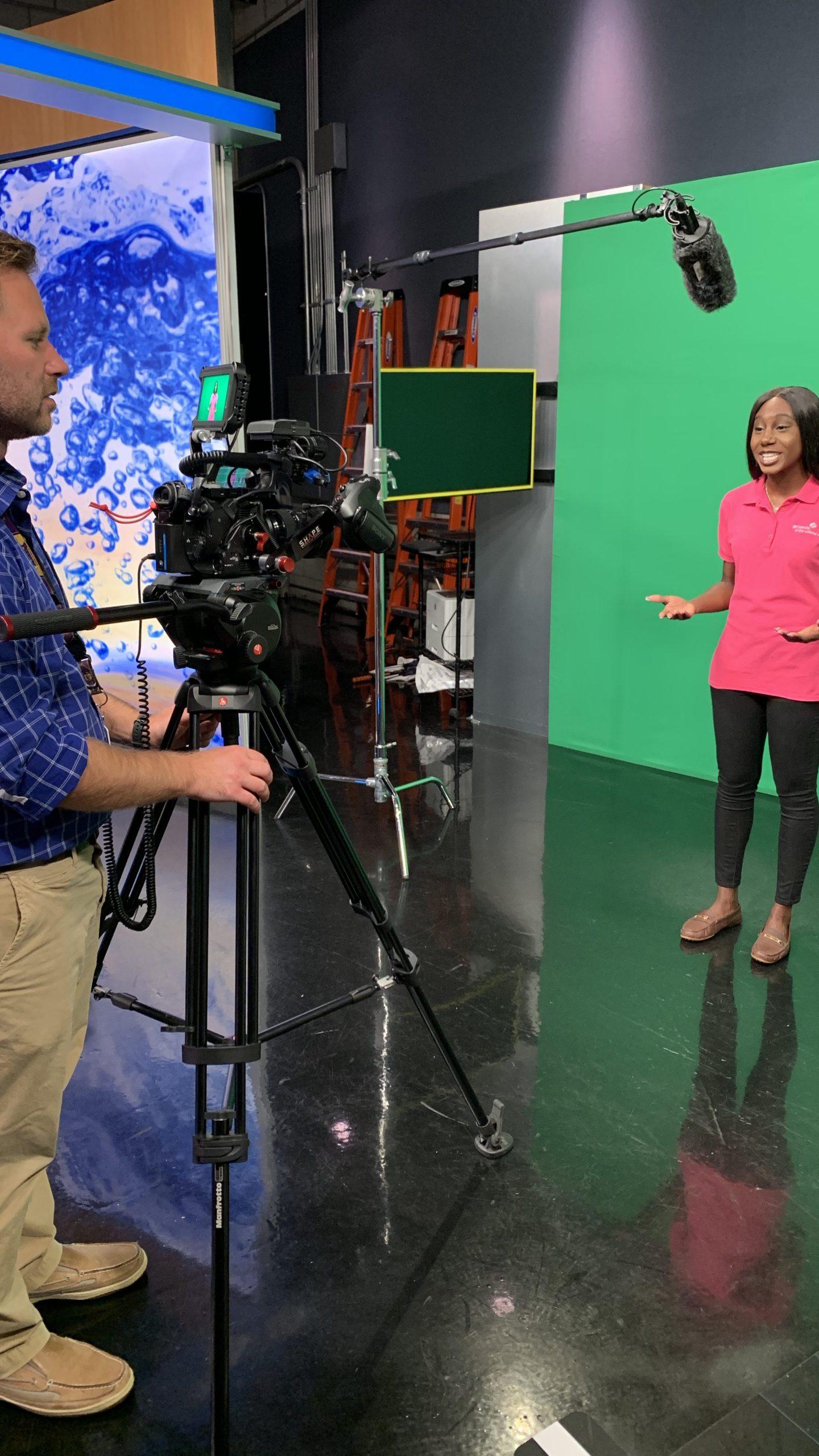 Reporter Symone Davis films a Promo for the Girls Scout Initiative.